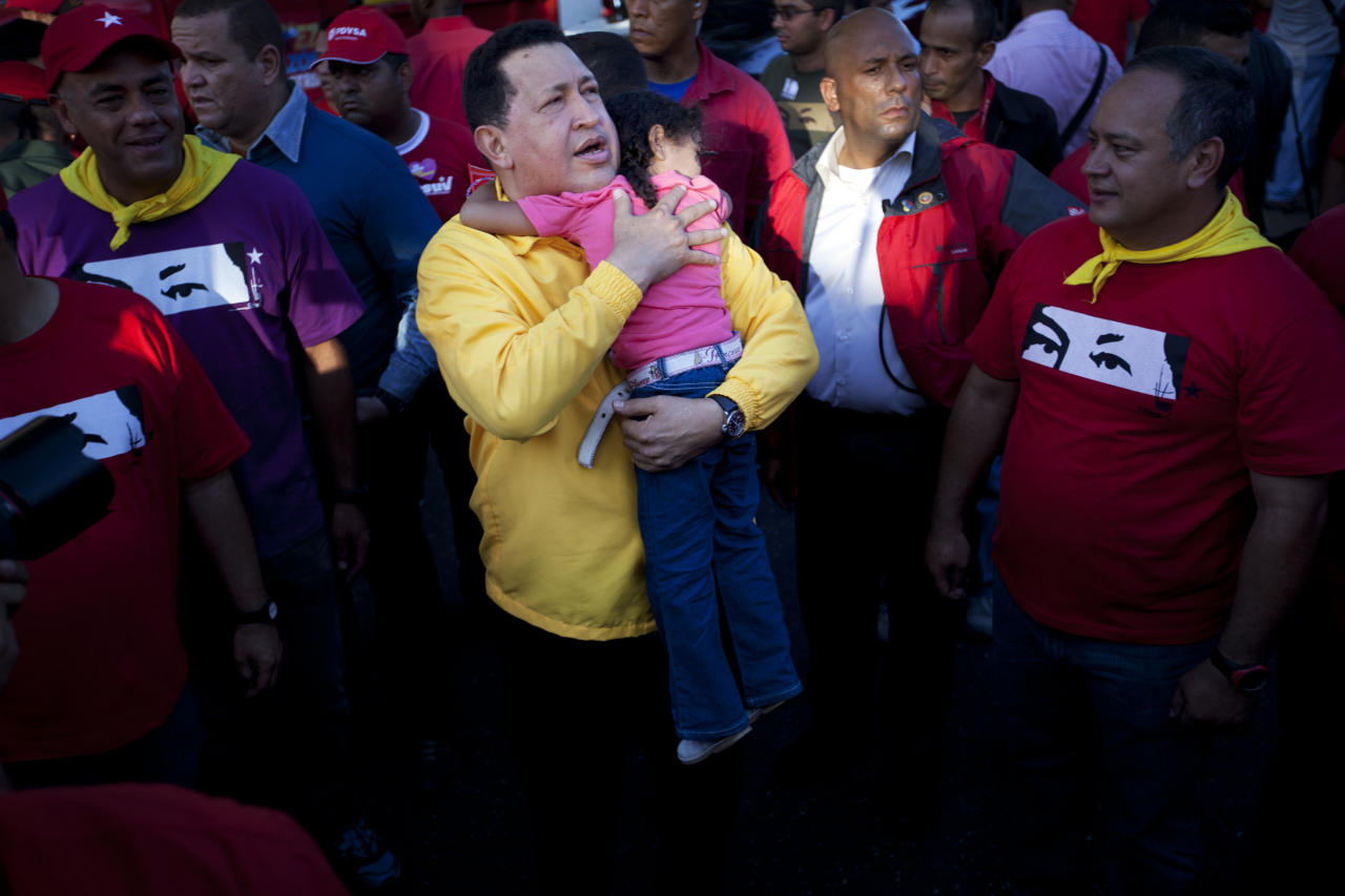 Venezuela's President Hugo Chavez embraces a girl during a campaign rally in Guarenas, Venezuela, Saturday, Sept. 29, 2012. Venezuela's presidential election is scheduled for Oct. 7. (AP Photo/Rodrigo Abd)