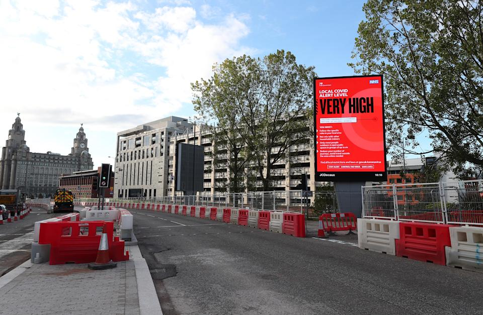 A Covid alert level sign in Liverpool after Prime Minister Boris Johnson set out a new three-tier system of alert levels for England following rising coronavirus cases and hospital admissions. (Photo by Peter Byrne/PA Images via Getty Images)