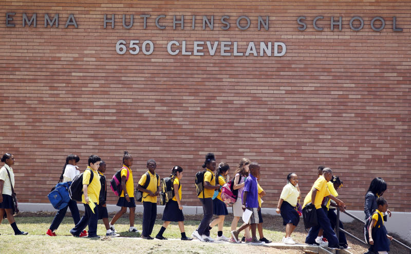 FILE - In a July 13, 2011 file photo, students at Emma Hutchinson School in Atlanta leave after the day's classes.  Hutchinson has been identified as one of forty four schools involved in a test cheating scandal.   A new state report reveals how far some Atlanta public schools went to raise test scores in the nation's largest-ever cheating scandal.  The scandal first came to light two years ago. Now, investigators have concluded that nearly half the city's schools allowed cheating to go unchecked for as long as a decade, beginning in 2001.  (AP Photo/John Bazemore, File)