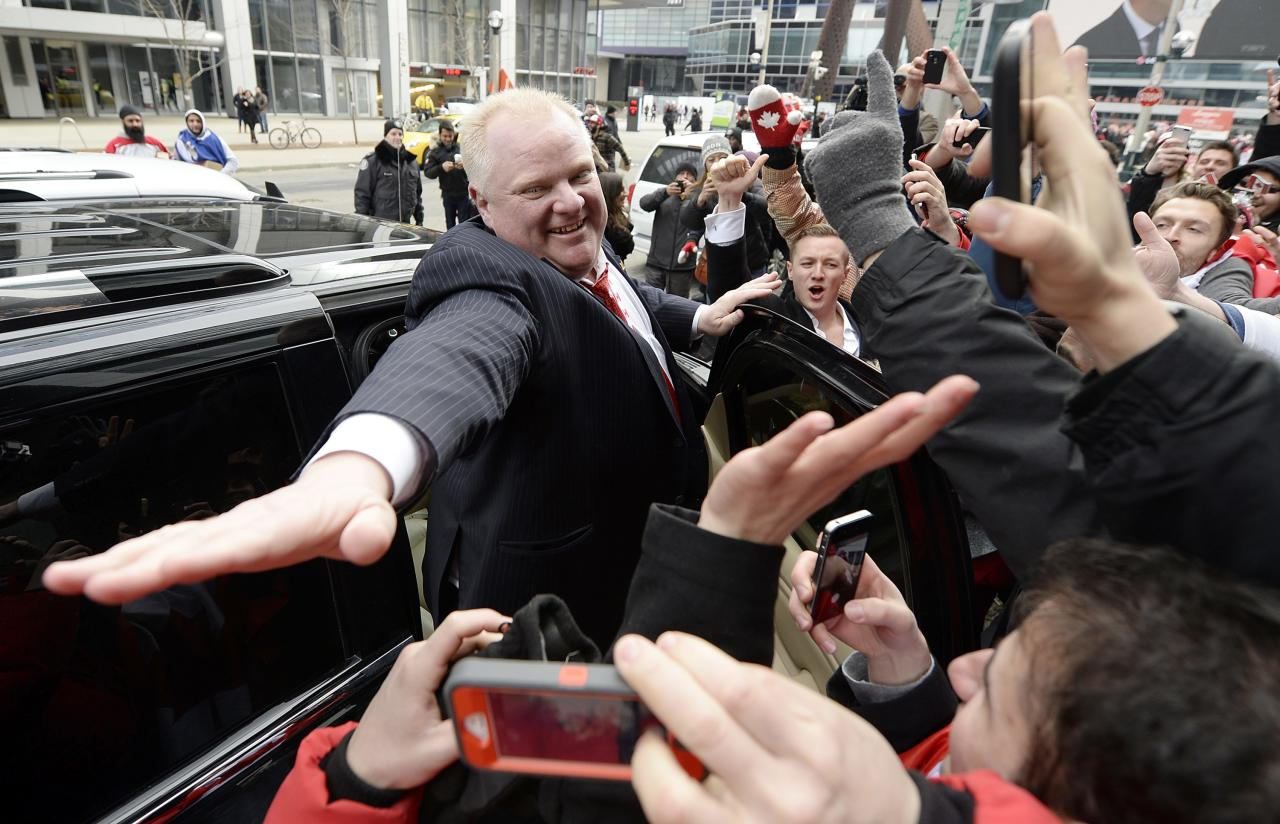 Toronto Mayor Rob Ford celebrates Team Canada's gold medal win over Sweden in the men's ice hockey gold medal game at the Sochi 2014 Winter Olympic Games, in Toronto, February 23, 2014. REUTERS/Aaron Harris (CANADA - Tags: POLITICS)