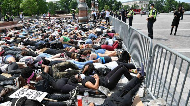 PHOTO: People lay down in protest over the death of George Floyd near the U.S. Capitol, June 3, 2020, in Washington, D.C. (Mandel Ngan/AFP via Getty Images)