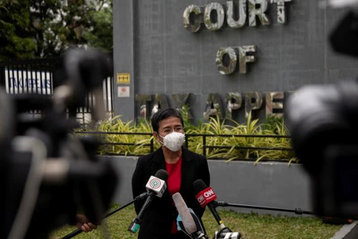 Filipino journalist and Rappler CEO Maria Ressa speaks to the media after testifying before the Court of Tax Appeals in Quezon City