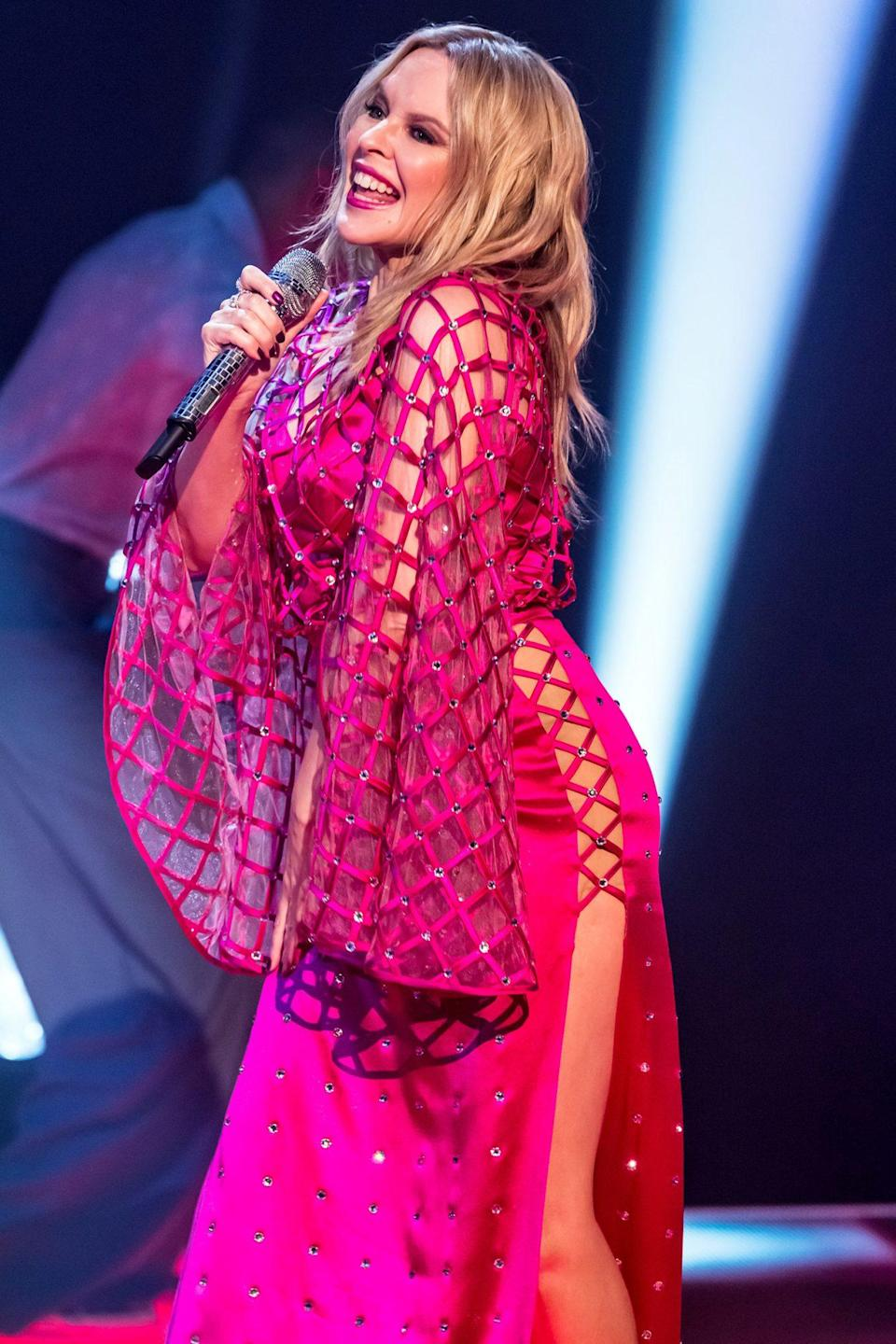 <p>Kylie Minogue hits the stage in a hot pink, bedazzled ensemble on <em>The Jonathan Ross Show</em> on Wednesday in London.</p>