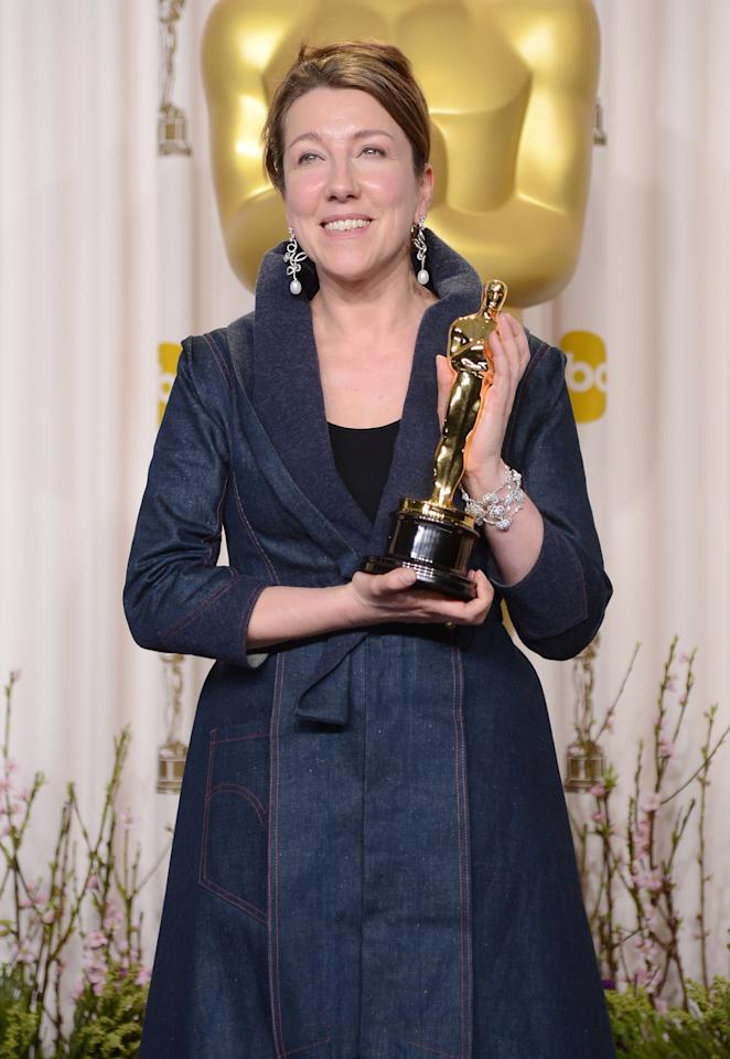 """HOLLYWOOD, CA - FEBRUARY 24:  Costume designer Jacqueline Durran, winner of the Best Costume Design award for """"Anna Karenina,"""" poses in the press room during the Oscars held at Loews Hollywood Hotel on February 24, 2013 in Hollywood, California.  (Photo by Jason Merritt/Getty Images)"""