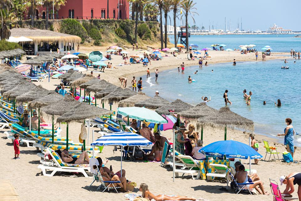 BENALMADENA, SPAIN – JULY 08: People play in the sea as they enjoy the hot weather at the beach on July 8, 2021 in Benalmádena, near Málaga, Spain. AEMET reported that Andalusia will see temperatures between 5-10 degrees Celsius higher than July's average during this weekend. They forecast that Malaga and Almeria will be hit with the highest temperatures. Yesterday Malaga was on Yellow alert for high temperatures due to a local weather phenomenon known as terral winds, hot air that blows from the north toward the coast. The Andalusian Government does not consider adopting more restrictive measures against the Covid-19 pandemic for now because the health situation in the community 'is not concerning' right now. (Photo by David Benito/Getty Images)