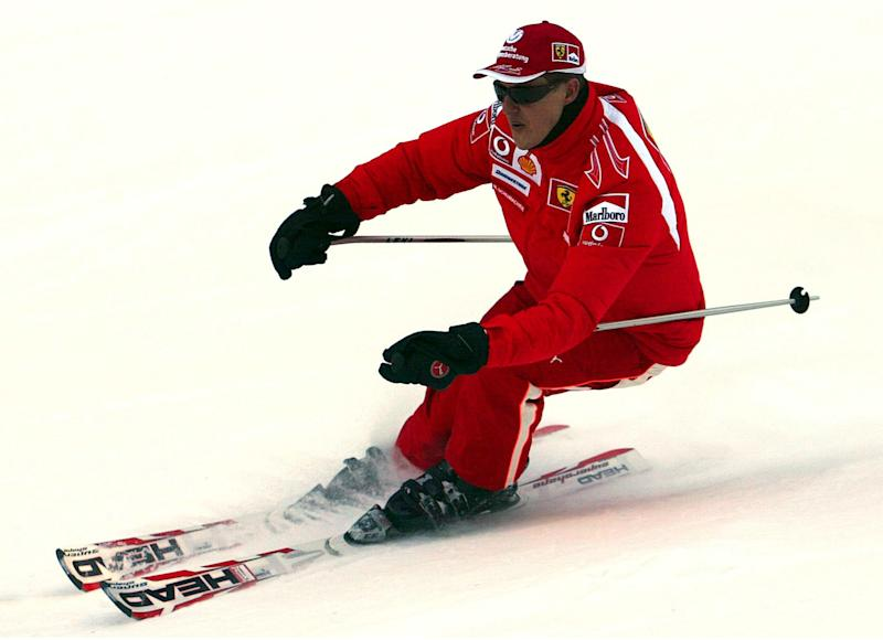FILE - In this Thursday, Jan. 12, 2006 file photo provided by the Ferrari press office, Formula One driver Michael Schumacher of Germany speeds down a course in the Madonna di Campiglio ski resort, in the Italian Alps . French radio says retired Formula One champion Michael Schumacher has been injured in a skiing accident. RMC radio reported Sunday Dec. 29, 2013 that the seven-time champion had fallen while skiing off-piste at the French Alpine resort of Meribel. The radio quoted resort director Christophe Gernigon-Lecomte as saying that Schumacher was wearing a helmet when he fell and hit a rock. (AP Photo/Ferrari, File)