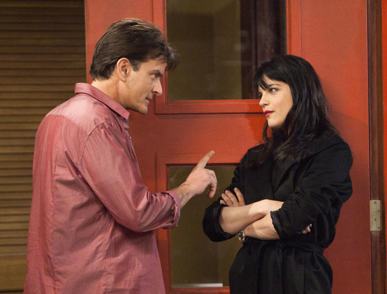 "This publicity image released by FX shows Charlie Sheen as Charlie Goodson and Selma Blair as Kate Wales in a scene from the new comedy ""Anger Management."" The series, Sheen's latest since leaving ""Two and a Half Men,"" premieres Thursday June 28, 2012 with a pair of back-to-back episodes at 9 p.m. on FX. (AP Photo/FX, Adam Rose)"