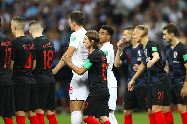 <p>Croatia's Luka Modric holds England's Harry Maguire during the FIFA World Cup, Semi Final match at the Luzhniki Stadium, Moscow. (Photo by Tim Goode/PA Images via Getty Images) </p>