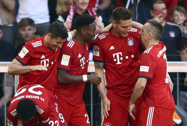 Bayern defender Niklas Suele, center right, celebrates with teammates after scoring his side's opening goal during the German Bundesliga soccer match between Bayern Munich and Werder Bremen at the Allianz Arena in Munich, Germany, Saturday, April 20, 2019. (AP Photo/Matthias Schrader)
