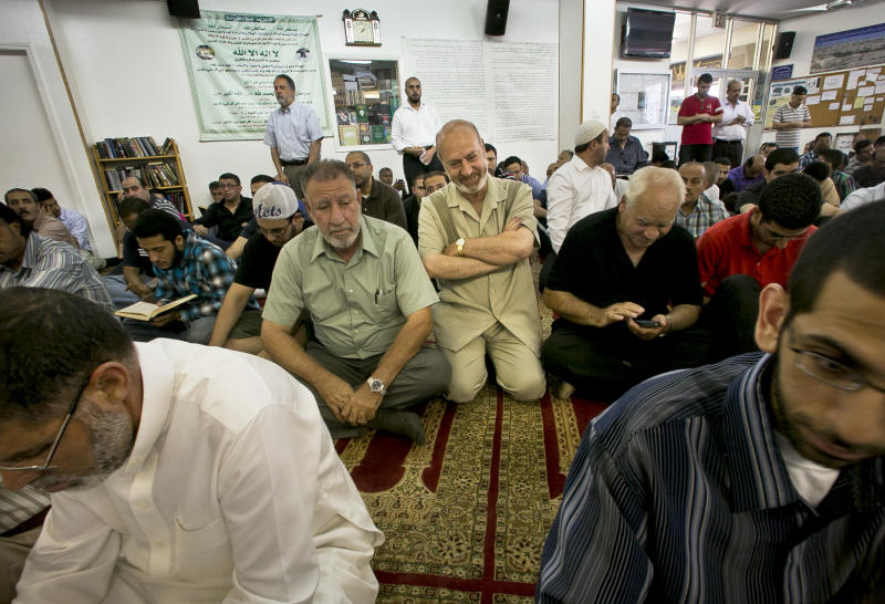 Zein Rimawi, 59, center, a leader and founder of the Islamic Society of Bay Ridge and mosque, join a congregation for a Jumu'ah prayer service at the mosque on Friday, Aug. 16, 2013, in Brooklyn borough of New York. The NYPD targeted his mosque as a part of a terrorism enterprise investigation beginning in 2003, spying on it for years. The mosque has never been charged as part of a terrorism conspiracy. (AP Photo/Bebeto Matthews)