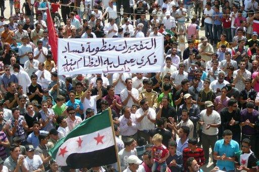 An image released by the Syrian opposition's Shaam News Network, shows an anti-regime demonstration in the town of Dael. Tens of thousands of protesters defied Syrian army gunfire and took to the streets, as state TV said the army foiled a would-be suicide attack a day after twin bombings in Damascus left scores dead