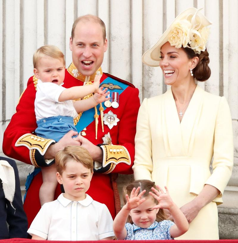 William, Kate, Prince George, Princess Charlotte and Prince Louis (in the duke's arms) watch a flyover from the balcony of Buckingham Palace during Trooping The Colour, the Queen's annual birthday parade, on June 8 in London.