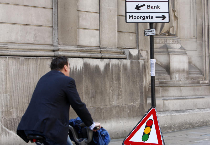 A cyclist passes a sign post indicating the direction to 'bank' near the Bank of England in London, Friday, Aug. 19, 2011. Global stocks slid again Friday as fears of a possible U.S. recession combined with ongoing worries over Europe's debt crisis, which is stoking acute fears over the continent's banking sector. (AP Photo/Akira Suemori)