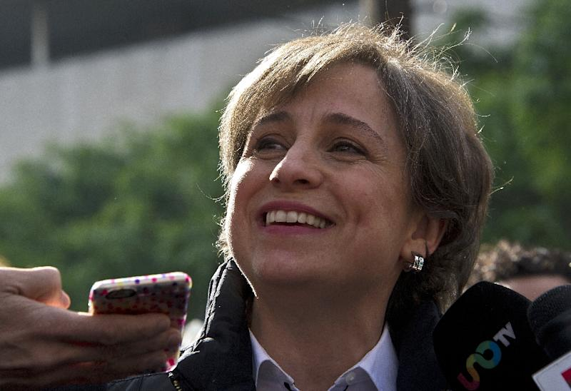 Mexican journalist Carmen Aristegui speaks to the press in Mexico City on March 16, 2015, a day after being fired (AFP Photo/Ronaldo Schemidt)