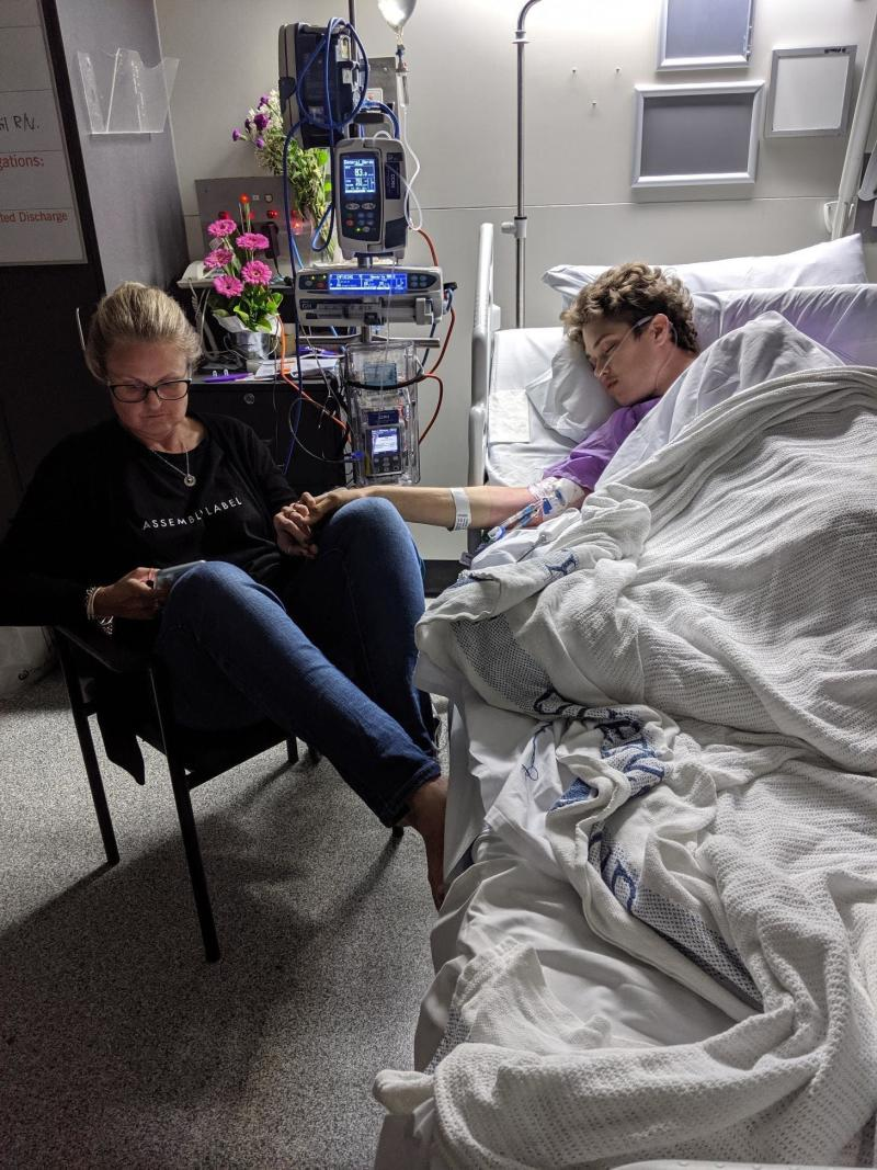 Ned Desbrow in hospital with his mother Melita Carlyon. Source: RACQ LifeFlight Rescue