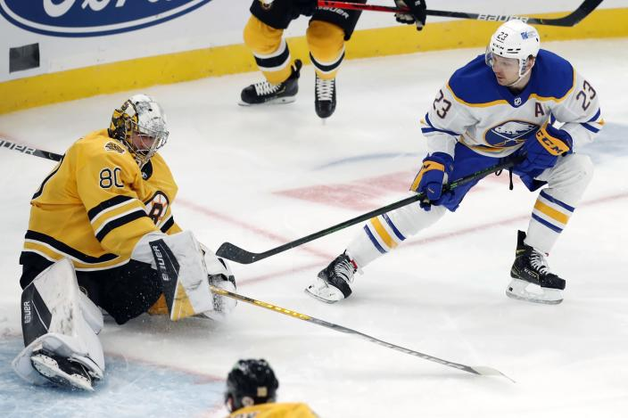 Buffalo Sabres' Sam Reinhart (23) scores on Boston Bruins' Dan Vladar (80) during the first period of an NHL hockey game, Saturday, March 27, 2021, in Boston. (AP Photo/Michael Dwyer)