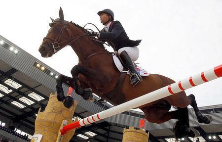 FILE PHOTO: France's Patrice Delaveau riding Orient Express HDC competes in the jumping first round third competition at the World Equestrian Games at the d'Ornano stadium in Caen