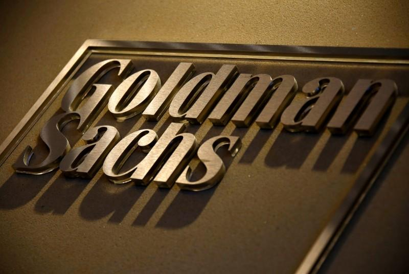 FILE PHOTO - A sign is displayed in the reception of the Sydney offices of Goldman Sachs in Australia