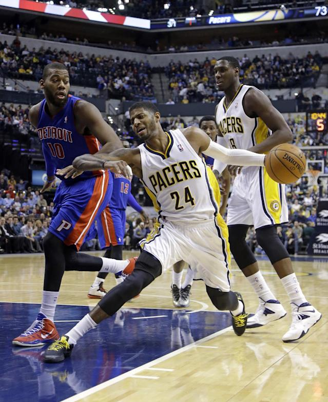 Indiana Pacers forward Paul George (24) cuts in front of teammate Ian Mahinmi, and Detroit Pistons forward Greg Monroe in the second half of an NBA basketball game in Indianapolis, Monday, Dec. 16, 2013. The Pistons defeated the Pacers 101-96. (AP Photo/Michael Conroy)