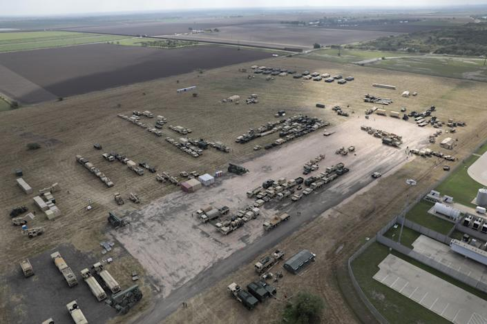 U.S. Army vehicles sit at a military camp under construction at the U.S.-Mexico border on November 7, 2018 in Donna, Texas.