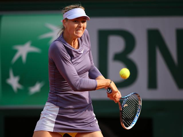 PARIS, FRANCE - JUNE 03: Maria Sharapova of Russia plays a backhand in her Women's Singles match against Sloane Stephens of United States of America during day nine of the French Open at Roland Garros on June 3, 2013 in Paris, France. (Photo by Julian Finney/Getty Images)