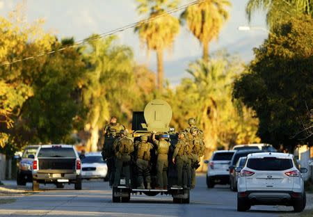 Police officers conduct a manhunt after a mass shooting in San Bernardino, December 2, 2015. REUTERS/Mike Blake