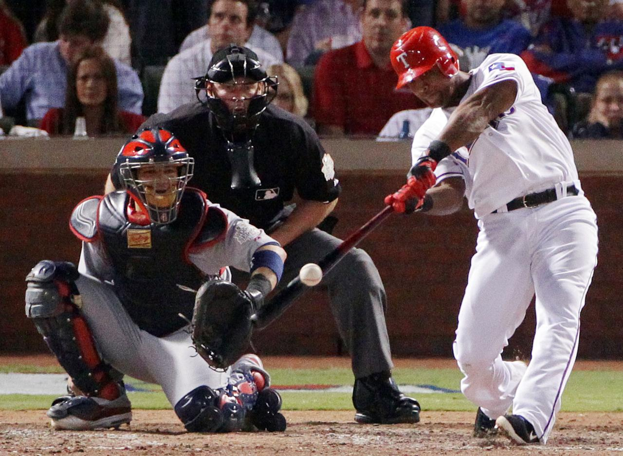 ARLINGTON, TX - OCTOBER 24:  Adrian Beltre #29 of the Texas Rangers hits a solo home run in the sixth inning during Game Five of the MLB World Series against the St. Louis Cardinals at Rangers Ballpark in Arlington on October 24, 2011 in Arlington, Texas.  (Photo by Doug Pensinger/Getty Images)