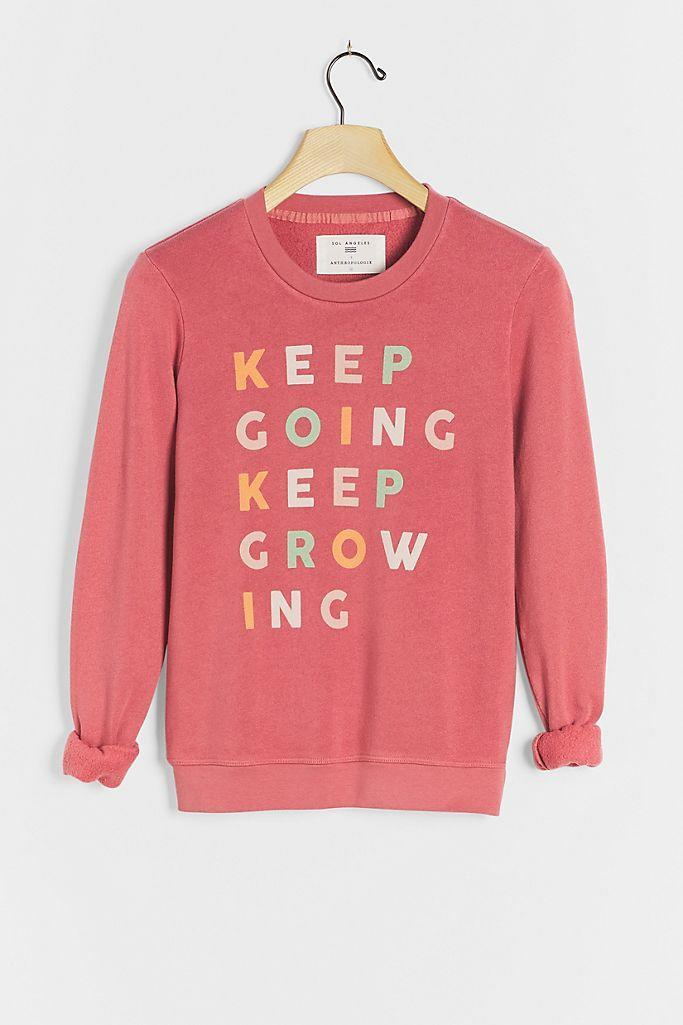 """<br><br><strong>Sol Angeles Anthropologie</strong> Keep Going Keep Growing Graphic Sweatshirt, $, available at <a href=""""https://go.skimresources.com/?id=30283X879131&url=https%3A%2F%2Fwww.anthropologie.com%2Fshop%2Fkeep-going-keep-growing-graphic-sweatshirt"""" rel=""""nofollow noopener"""" target=""""_blank"""" data-ylk=""""slk:Anthropologie"""" class=""""link rapid-noclick-resp"""">Anthropologie</a>"""