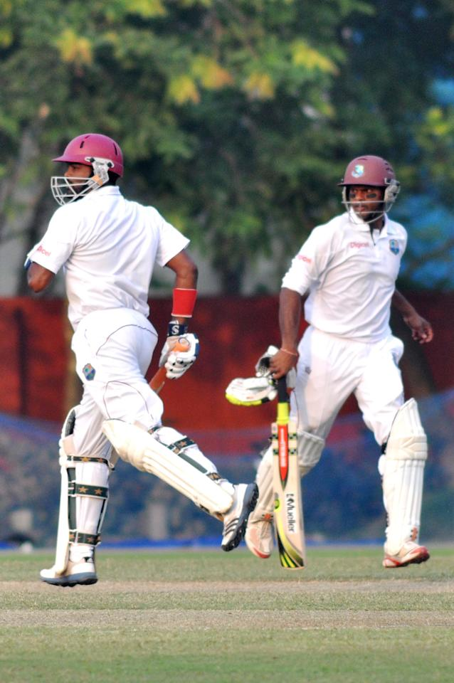 West Indies player N Deonarine and S Chanderpaul in action during Day one of practice match between West Indies and Uttar Pradesh Cricket Association XI at the Jadavpur University Ground in Kolkata on Oct 31, 2013. (Photo: IANS)
