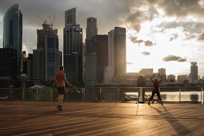 SINGAPORE - 2020/05/16: People exercise outside Marina Bay Sands during the Coronavirus (COVID-19) crisis. Singapore has so far confirmed 27,356 coronavirus cases, 22 deaths and 8,342 recovered, based on the latest update by the country's Ministry of Health. (Photo by Maverick Asio/SOPA Images/LightRocket via Getty Images)