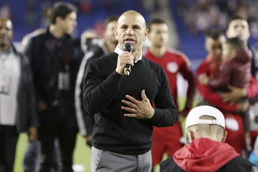 New York Red Bulls head coach Chris Armas speaks to the fans after an MLS soccer match against Orlando City, Sunday, Oct. 28, 2018, in Harrison, N.J. The New York Red Bulls won 1-0. (AP Photo/Steve Luciano)