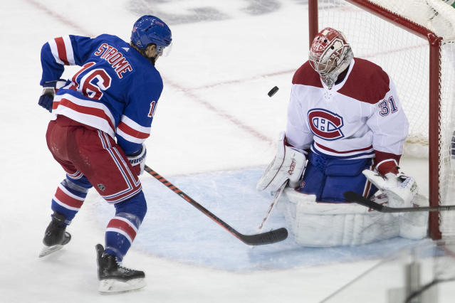 Montreal Canadiens goaltender Carey Price (31) makes a save against New York Rangers center Ryan Strome (16) during the third period of an NHL hockey game Friday, Dec. 6, 2019, at Madison Square Garden in New York. The Canadiens won 2-1. (AP Photo/Mary Altaffer)