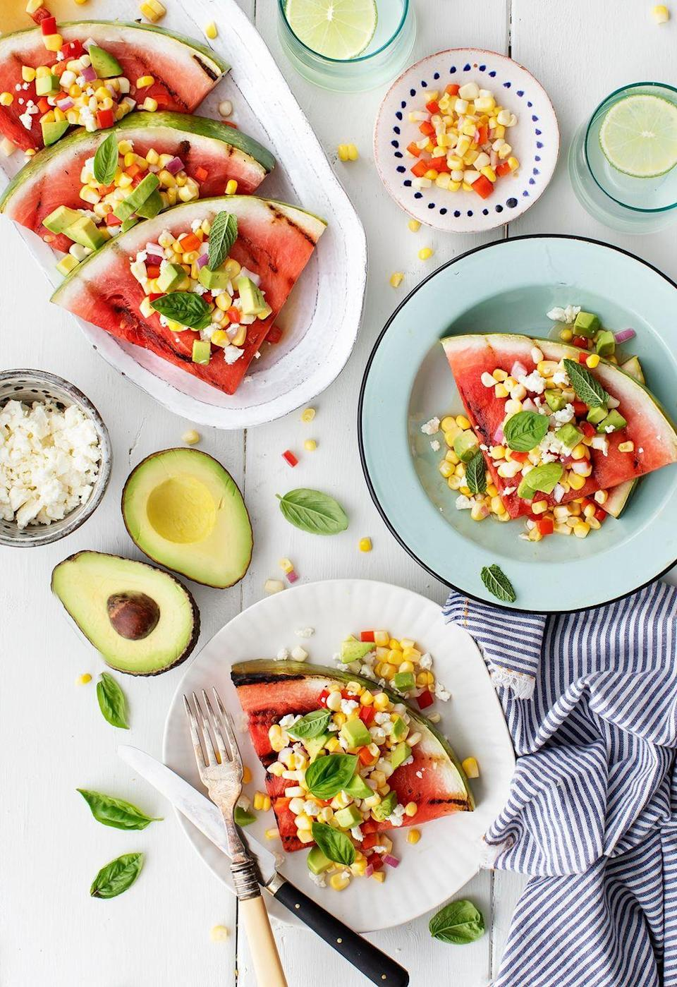 """<p>For an unexpected vegetarian side, consider grilled watermelon topped with a zesty mix of fresh corn, feta, avocado, and basil.</p><p><a href=""""https://www.loveandlemons.com/grilled-watermelon/"""" rel=""""nofollow noopener"""" target=""""_blank"""" data-ylk=""""slk:Get the recipe."""" class=""""link rapid-noclick-resp"""">Get the recipe. </a></p>"""