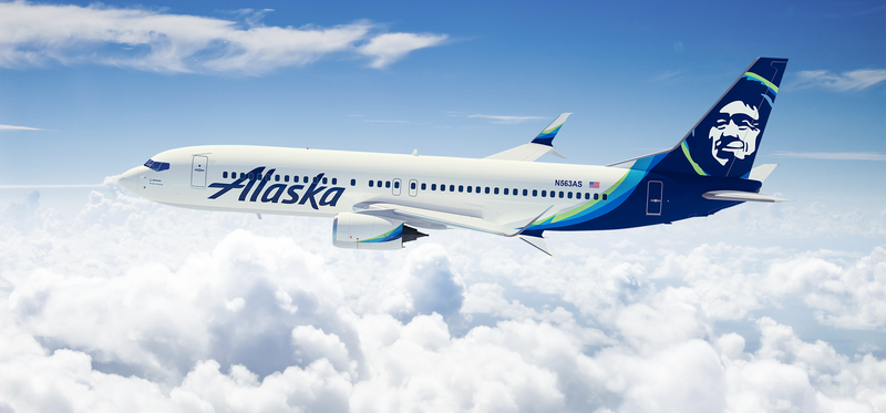 An Alaska Air plane in the sky.