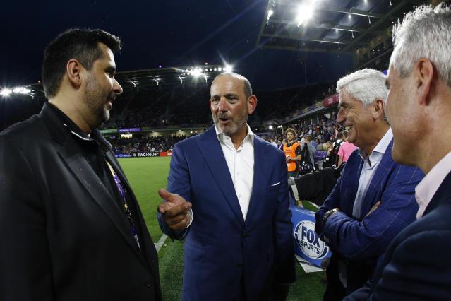 Commissioner Don Garber (center) and Major League Soccer are in for a showdown with the Players Association ahead of next season. (Reuters)