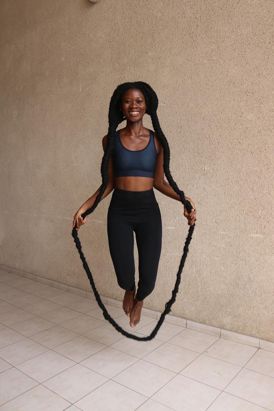 Laetitia Ky is the record holder for the most skips over own hair in 30 seconds (Image: GUINNESS WORLD RECORDS 2022)