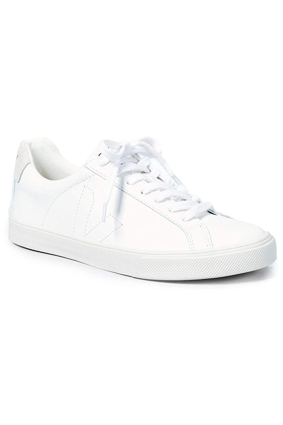 """<p><strong>Veja</strong></p><p>amazon.com</p><p><strong>$120.00</strong></p><p><a href=""""https://www.amazon.com/dp/B00I8PI4O8?tag=syn-yahoo-20&ascsubtag=%5Bartid%7C10063.g.34824549%5Bsrc%7Cyahoo-us"""" rel=""""nofollow noopener"""" target=""""_blank"""" data-ylk=""""slk:Shop Now"""" class=""""link rapid-noclick-resp"""">Shop Now</a></p><p>White leather sneakers defined the last decade in fashion and aren't going away anytime soon. Gift her a pair from Veja, the sustainable brand she's been trying to track down in her size these last few months.</p>"""