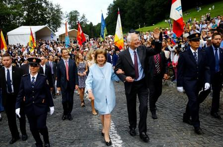 Prince Hans-Adam II of Liechtenstein waves as he is accompanied by wife Princess Marie and their son Hereditary Prince Alois of Liechtenstein in Vaduz