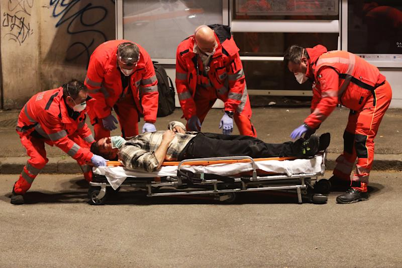The man was then carried away by the medical personnel from an ambulance. Source: Getty Images