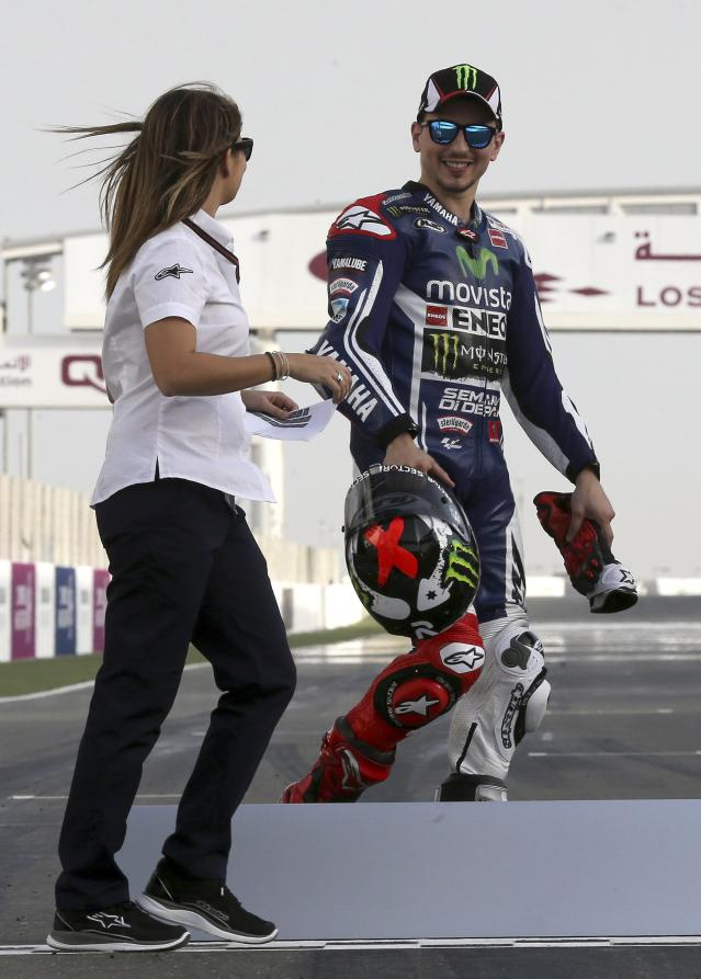 Yamaha MotoGP rider Jorge Lorenzo of Spain is seen before the free practice session of the MotoGP World Championship at the Losail International circuit in Doha March 20, 2014. REUTERS/Fadi Al-Assaad (QATAR - Tags: SPORT MOTORSPORT)