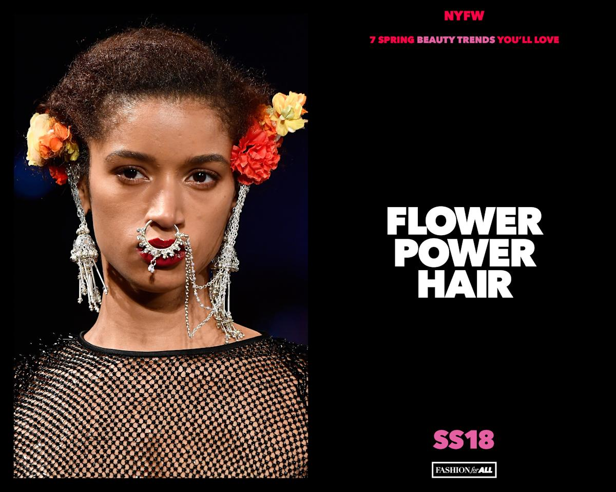 <p>Flower crowns are over, but that doesn't mean you have to stop wearing flowers in your hair. Here's how it's done. </p>