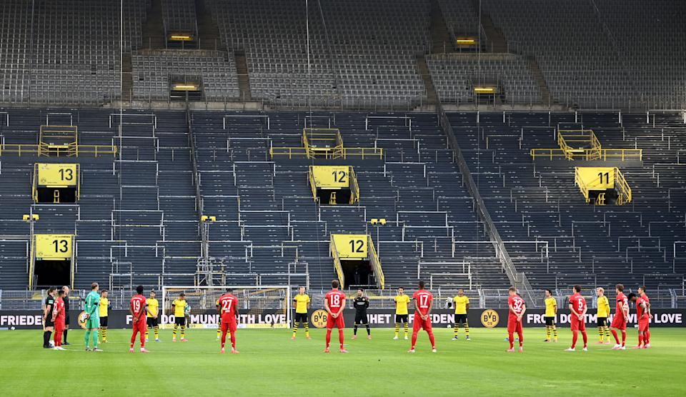 DORTMUND, GERMANY - MAY 26: Players and officials take part in a minute of silence  to commemorate those affected by the Coronavirus pandemic prior to the Bundesliga match between Borussia Dortmund and FC Bayern Muenchen at Signal Iduna Park on May 26, 2020 in Dortmund, Germany. (Photo by Federico Gambarini/Pool via Getty Images)