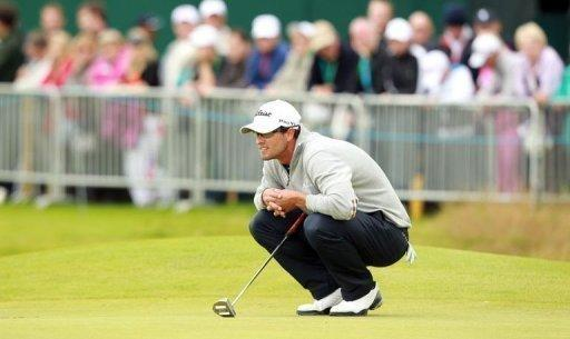 Australia's Adam Scott lines up a putt during his second round on day two of the British Open at Royal Lytham and St Annes in England. Scott stood second on eight-under through 13 holes