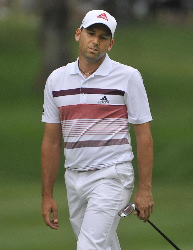 Sergio Garcia reacts after missing a birdie putt on the 13th hole, during the third round of the Bridgestone Invitational golf tournament, Saturday, Aug. 2, 2014, in Akron, Ohio. (AP Photo/Phil Long)