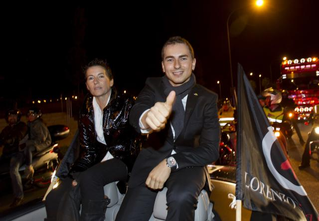 Moto GP world champion Spain's rider Jorge Lorenzo (R) gives the thumb up as he sits in a car in Palma de Mallorca during a parade on November 19, 2012. AFP PHOTO/ JAIME REINAJAIME REINA/AFP/Getty Images