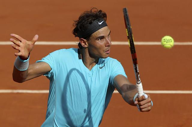 Spain's Rafael Nadal volleys the ball to Serbia's Novak Djokovic during their final match of the French Open tennis tournament at the Roland Garros stadium, in Paris, France, Sunday, June 8, 2014