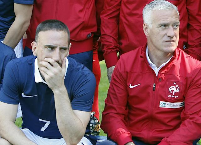 France's forward Franck Ribery, left, and head coach Didier Deschamps pose for the team picture at the French national football team's training base, in Clairefontaine, outside Paris, Friday, June 6, 2014 as part of France's national football team's preparation for the upcoming FIFA 2014 World Cup in Brazil. Deschamps told a news conference that Ribery, 31, has been ruled out after injuring his lower back in a training session on Friday. (AP Photo/Francois Mori)