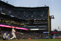 San Francisco Giants' Buster Posey hits an RBI single in front of Los Angeles Dodgers catcher Will Smith during the sixth inning of a baseball game in San Francisco, Tuesday, July 27, 2021. (AP Photo/Jeff Chiu)