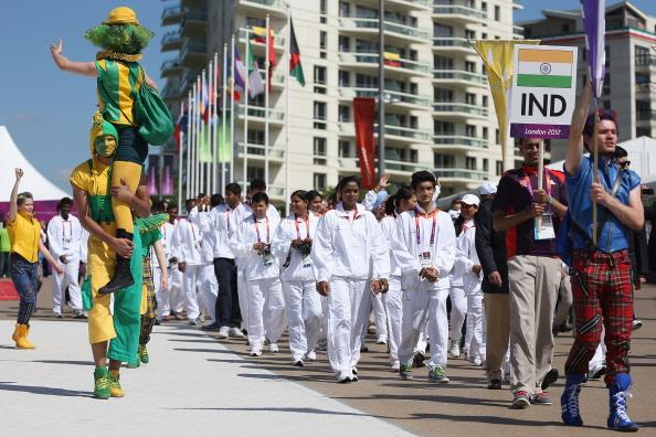 LONDON, ENGLAND - JULY 22:  The India Olympic team and delegates enter the athlete's village during a welcome ceremony with a performance by the National Youth Theatre of Great Britain at Olympic Park on July 22, 2012 in London, England.  (Photo by Feng Li/Getty Images)