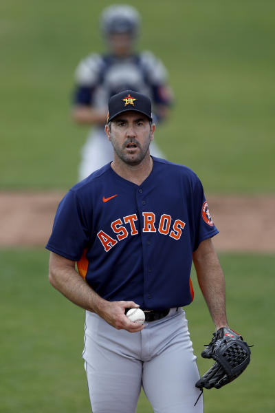 Houston Astros pitcher Justin Verlander warms up prior to a spring training baseball game against the St. Louis Cardinals, Tuesday, March 3, 2020, in Jupiter, Fla. (AP Photo/Julio Cortez)